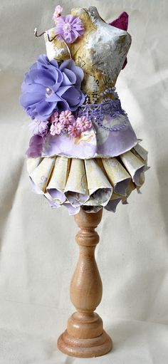 Dress form on candlestick ~ not fabric but could be interpreted with fabric..... + stitchery .... + ribbonery