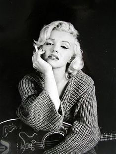 Marilyn Monroe... back when smoking was cool. Go figure. Yuck. Still...she never took a bad picture.