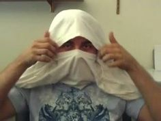 In this video, we learn how to make a ninja mask out of a t-shirt. First, grab your t-shirt and then roll it up until you get to the head opening. Now, stick your head through the hole and take your sleeves out. Now, take the back of the shirt and roll it over the top of the head and bring the top of the shirt up to the top of your nose. Now, tie the sleeves behind your head and tuck the rest of the shirt underneath the top of the shirt you're wearing. When you are done, you will have a…
