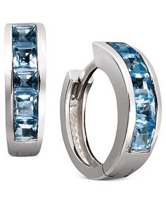 Cool off in blue hues. Baguette-cut blue topaz (2-1/2 ct. t.w.) adds chic, calming color to a traditional pair of hoops. Crafted in sterling silver. Approximate diameter: 1/2 inch.