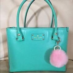 Kate Spade bag Super cute Kate Spade tote. Great used condition. Perfect and bright for summer! Make me an offer. Cheaper on Merc. Does not come with pink pom. kate spade Bags Totes