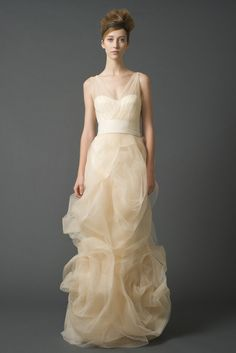 Vera Wang Gabriella (#120311)   Alluring stretch charmeuse V-neck mermaid gown with illusion corset top, cut blossom skirt with a dreamy tulle overlay and finely woven trim.