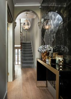 Grade II listed townhouse hallway with view to rear garden, smoky mirrored wall gives appearance of width, gold console table and feature light fitting Architects London, Hallway Flooring, Traditional Staircase, Timber Structure, Concrete Steps, Residential Architect, Solid Wood Flooring, Planning Permission, Georgian Homes