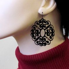 These stunning laser-cut statement earrings are made from black acrylic,they hang on NICKEL FREE Gunmetal plated over brass earwires and measure 2.5 inches tall by 1.8 inches wide.(65X45 mm).     These earrings make a bold statement, yet are surprisingly lightweight and easy to wear.     All of my jewelry comes with a gift box.    Price: $36.9