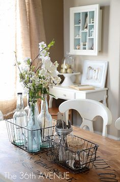 Yes please..... Stenciled table top, wire crates, vintage bottles, mason jars and burlap curtains.