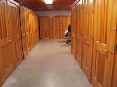 But with metal grill locker walls and doors to facilitate air flow and a lighter feel. Add a tack cleaning/social area with benches/chairs next to the laundrette space? Horse Arena, Horse Stables, Tack Locker, Horse Tack Rooms, Shed Sizes, Tech Room, Tack Trunk, Warehouse Design, Round Pen