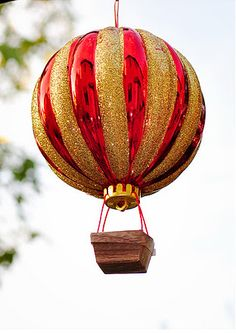 add a small basket to an ordinary christmas tree ornament. Easy hot air balloon decorations!