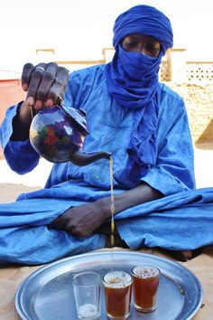 Man pouring tea in Timbuktu. Yum. Photo credit: Julienne Oyler.
