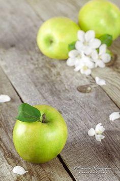 Green apple on a hardwood floor