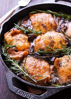 Garlic Rosemary Chicken Thighs Flavorful Oven Roasted Rosemary Chicken Thighs in Wine Sauce will create a mouth watering aroma aro Oven Roasted Chicken Thighs, Chicken Thighs Mushrooms, Chicken Thigh Recipes Oven, Chicken Thighs Cast Iron, Cast Iron Chicken Recipes, Garlic Rosemary Chicken, Garlic Minced, Wine Recipes, Cooking Recipes