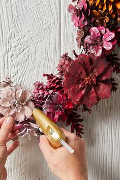 Pinecone Flower Wreath Make a gorgeous fall wreath that features painted pinecones. We'll show you how to decorate and attach the cones in just a few minutes! Christmas Tree Wreath, Prim Christmas, Christmas Tree Decorations, Country Christmas, Pine Cone Art, Pine Cone Crafts, Pine Cones, Pine Cone Flower Wreath, Painted Pinecones