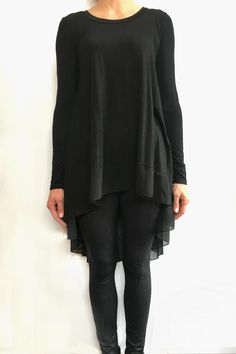 "This black knit/chiffon top is perfect paired with leggings or jeans. The flowy style is complementary to petite shapes or frames that want to hide tummy or backside. Fitted long sleeve. It's flirty and fun and can easily be dressed up or down. Model is wearing XS and is 5'3"" height.  Black Tunic by Papillon. Clothing - Tops - Tunics Alberta Canada"