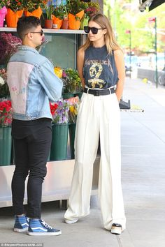 Gigi Hadid stops to admire the flowers on NYC stroll