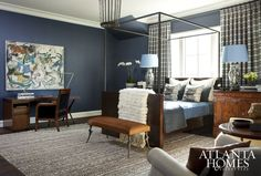 Vivid blues and burnished bronzes create an intimate feeling in the upstairs guest suite, where Karen Ferguson mixed saturated color and rich materials for a layered effect.