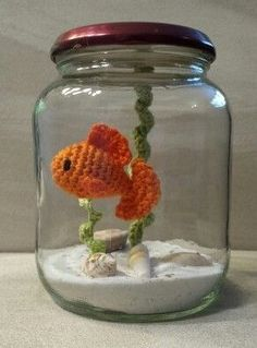 crochet fish in a jar,sand and shells no water needed just a hook and thread and jar. little treasure. Crochet Fish, Cute Crochet, Crochet Animals, Crochet Baby, Crochet Patterns Amigurumi, Crochet Dolls, Felt Patterns, Knitting Patterns, Yarn Projects