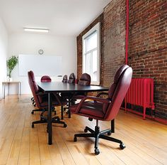 Mailbox Rental, Meeting Room, Coworking Space & Private Office Space - The Network Hub Mailbox Rental, Event Space Rental, Coworking Space, Brick Wall, Man Cave, Living Spaces, Flooring, Interior Design, Table