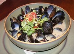 Bring some magic to your kitchen and try this Prince Edward Island Mussels Recipe from Le Cellier at EPCOT in Disney World