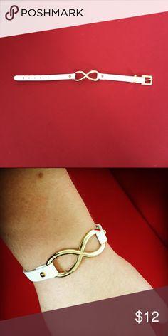 NWOT Infinity Bracelet Infinity Bracelet - gold and white with a buckle style clasp Jewelry Bracelets