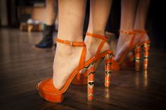 Bright orange and high-heeled #shoes at Sander #NYFW presentation. (Photo: Deidre Schoo for The New York Times)