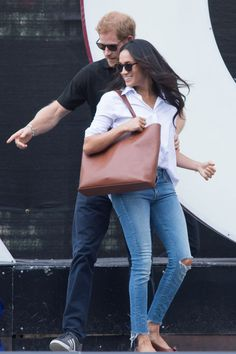 September 25, 2017 — After much anticipation, Meghan Markle and Prince Harry finally appeared together in public for the first time this week. Meghan chose Misha Nonoo's husband shirt and ripped blue jeans for their outing at the Invictus Games. Luckily you can get a similar poplin top on Amazon for a fraction of $185 price tag. BUY NOW