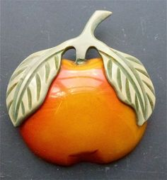 Overdyed bakelite apple with applied celluloid leaves   Bakelite Museum
