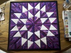 "Quilts - Tanya Goffman; paper-pieced purple star.  Each sliver of each diamond is 1/4"" finished."