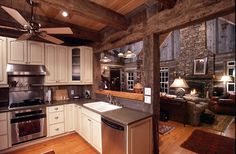 Open to the vaulted Great Room, this modern kitchen is tempered by the hand hewn posts and beams.