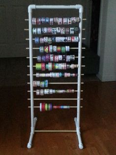 Ribbon or Washi tape holder...WOW made from PVC pipe. (CHEAP TO DO)  I need to modify this for a small garment rack.