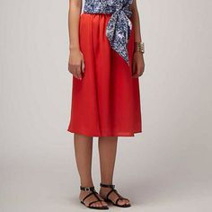 Red Midi Skirt wear with a black crop top or a sequinned top and mojris.