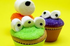 Simple Mini Cupcake Monsters by Meghan Mountford.  It just takes colored frosting, marshmallows and an edible pen.