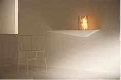 If you are planning to have a fireplace up on your wall, then how about a shelf mounted piece like this?