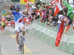 The new overall leader, Thibaut Pinot, raises his arms as he crosses the finish line to win the 5th stage of the 79th Tour de Suisse UCI ProTour cycling race in Soelden, Austria.  Jean-Christophe Bott, Keyston, via AP
