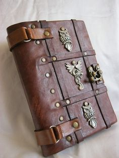 Luxry handmade blank leather journal notebook ''dragon'' emblem. $62.99, via Etsy.