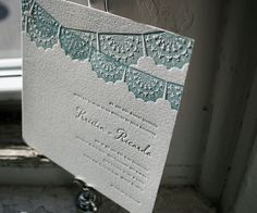 Traditional papel picado takes center stage with Barcelona, a letterpress wedding invitation with timeless, colorful appeal.