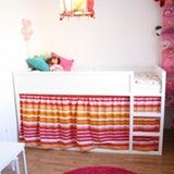 White paint and a colorful striped curtain liven up this KURA in a young girl's room. NieFrida