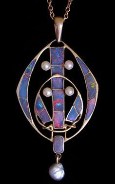 ARCHIBALD KNOX (1864-1933) LIBERTY & Co. A gold pendant inset with opal plaques and pearls and with a pearl drop. English. Circa 1900.
