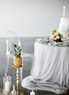 Pineapple on a stand | Carrie King Photographer & Sunflower Creative | see more on: http://burnettsboards.com/2015/03/time-celebrate-burnetts-boards-turns-3/