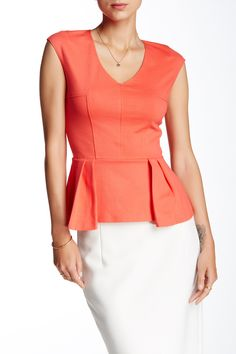 Yes!  Great color, cute top, and no tucking in!   V-Neck Ponte Peplum Blouse by Necessary Objects on @nordstrom_rack