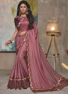 For a stunning and sophisticated look, opt for this beautiful purple color satin silk embroidered party wear saree. Pair this beautiful saree with the matching jewelry and classy clutch. Saree Designs Party Wear, Party Wear Sarees, Trendy Sarees, Fancy Sarees, Art Silk Sarees, Silk Sarees Online, Latest Saree Trends, Purple Saree, Shopping