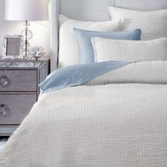 Brighten your bedroom with our soft and luxurious pure White Aria quilt set.