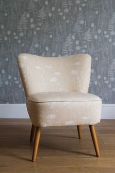 Cocktail chair upholstered in golden yellow daisy meadow fabric by Hannah Nunn - a print inspired by Norwegian meadows full of daisies, grasses, harebells, stitchwort, shepherds purse and quaking grass.