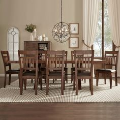 Two end extension leaves feature grain that runs perpendicular to the main acacia veneered table top, lending a unique look to this collection. Each chair back features both horizontal and vertical slats as well as a brown bi-cast vinyl seat. Each chair stands 18 inches high and features a high back. Those features respectively make it easy to get out of the seat, and provide ample support when seated. The cushions are filled with polyurethane foam that makes it more pleasant to sit during lengthy conversations and multi-course dinners. This contemporary set is a great option if you're getting set for gatherings among family members and friends.