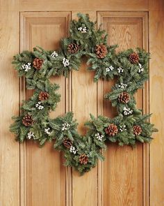 Step outside the box with a star-shaped wreath. This one will carry a front door from fall through the holidays.