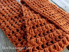 The Ginger Snap Infinity Scarf is warm and toasty like a wonderful ginger snap cookie. Worked in alternating rows of puff stitches a...
