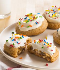 Mini Snickers bars are baked inside this irresistible and easy peanut butter cookies. Topped with creamy frosting and sprinkles, they're a birthday-party worthy treat!
