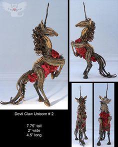 rearing unicorn devil claw seed pod sculpture