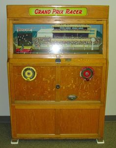 """Vintage Ruffler & Walker """"Grand Prix Racer"""" coin-op arcade machine. Players insert coins and then turn the handcranks to race each other .. purely a skill game, no prizes."""