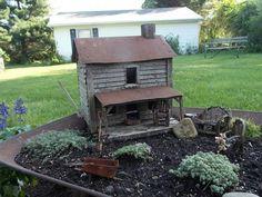 small cabin in garden setting...