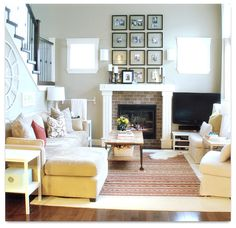 sarah richarson living room,    i like the photo frams that can see through to the wall.
