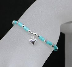 beautiful summer Bracelet made with 925 sterling silver balls and Teal Toho Seed Beads and finished off with a gorgeous 9 mm sterling silver puffy heart. Stretch Bracelets, Beaded Bracelets, Silver Jewelry Cleaner, Summer Bracelets, Heart Bracelet, 9 Mm, Silver Beads, Bracelet Making, Sterling Silver Bracelets